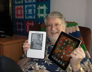 Barnett with his Kindle and iPad.