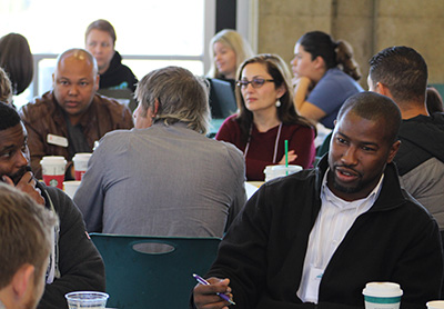 Day two began with a networking breakfast, where attendees were grouped by functional roles. Here, Tijan White of Ohlone College discusses issues with fellow Starfish users.