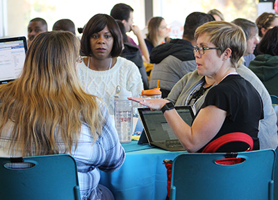 Breanna Andrews of Crafton Hills College shares her insight during the networking breakfast on day two of the summit.